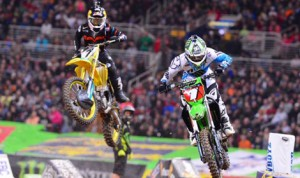 James Stewart (7) races alongside Ryan Villopoto during Saturday's Monster Energy AMA Supercross event at the Edward Jones Dome in St. Louis, Mo. (Simon Cudby Photo)