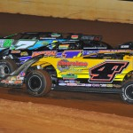 Robby Moses (7), Davey Johnson (1) and Tommy Kerr (4T) race three-wide during a heat race as part of Friday's National Dirt Racing League event at Tennessee's Smoky Mountain Speedway. (Michael Moats Photo)