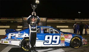 Patrick Staropoli, driver of the #99 PEAK Toyota, celebrates in victory lane after the NAPA Auto Parts 150 at Irwindale Speedway in Irwindale, California. (NASCAR Photo)