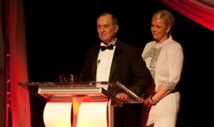 Bob Bondurant, with wife Pat, accepts his SCCA Hall of Fame honor Saturday in Charlotte, N.C. (Philip Royle/SportsCar Magazine Photo)