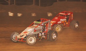 Damion Gardner (4) charges under Mike Spencer Saturday night at Perris Auto Speedway. (Doug Allen photo)