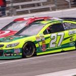 Paul Menard (27) battles Kyle Larson during Monday's NASCAR Sprint Cup Series race at Texas Motor Speedway. (HHP/Alan Marler Photo)