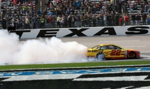 Joey Logano celebrates after winning Monday's Duck Commander 500 at Texas Motor Speedway. (HHP/Tami Kelly Pope Photo)