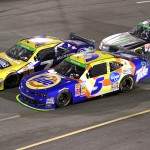 Regan Smith (7), Kevin Harvick (5) and Kyle busch (54) battle during the ToyotaCare 250 at the Richmond Int'l Raceway in Richmond, Va. (HHP photo/Alan Marler)