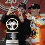 Kevin Harvick, right, takes a photo with car owner Dale Earnhardt Jr. after Harvick won the NASCAR Nationwide Series' ToyotaCare 250 Friday at Richmond Int'l Raceway in Richmond, Va. (HHP/Harold Hinson)