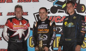 Ian Madsen (center) shares the podium with Brooke Tatnell (left) and Justin Henderson Saturday at Knoxville Raceway. (Danny Howk photo)