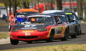Alex Bolanos leads the pack en route to victory during Sunday's Spec Miata race. (F&S Enterprises photo)