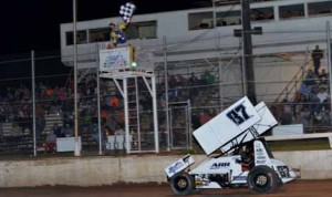 Aaron Reutzel crosses the finish line to win Saturday's Lucas Oil ASCS Sprint Car Dirt Series feature at I-30 Speedway in Arkansas. (Scott Frazier Photo)