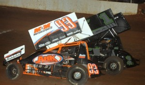Dustin Morgan (93) battles eventual ASCS sprint car winner Sean McClelland at Springfield Raceway. (Ken Simon photo)