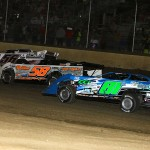 Late models battle three wide during the Slocum Memorial at 34 Raceway in West Burlington, Iowa, on Saturday. (Mike Ruefer Photo)
