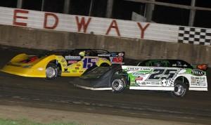 Jason Fegers (25) races under Brian Birkhofer at Davenport (Iowa) Speedway. (Mike Ruefer photo)