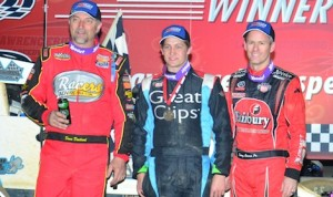 Josh Grant (center) shares the podium with Dave Darland (left) and Jerry Coons Jr. at Indiana's Lawrenceburg Speedway. (Doug Vandeventer photo)