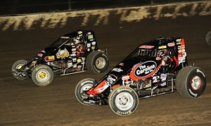 Dave Darland (71p) battles Tracy Hines en route to winning theUSAC sprint car feature at Eldora (Ohio) Speedway on April 19. (Julia Johnson photo)