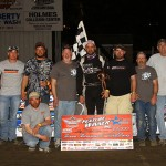 Colby Springsteen stands in victory lane after winning Saturday's Deery Brothers Summer Series event at West Liberty (Iowa) Raceway. (Mike Ruefer Photo)
