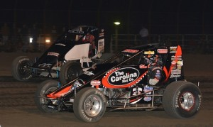 Tracy Hines (4) races under Scotty Weir en route to winning Friday's USAC sprint car feature at Gas City I-69 Speedway. (David E. Heithaus photo)