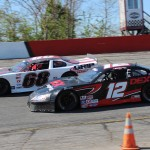 Harrison Burton (12) battles beside Clay Rogers during the PASS South Easter Bunny 150 on April 20 at Hickory (N.C.) Motor Speedway. (Adam Fenwick photo)