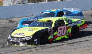 D.J. Shaw (60) passes Preston Peltier on his way to victory in Sunday's Easter Bunny 150. (Adam Fenwick Photo)