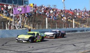 D.J. Shaw (60) beats Tyler Church to the finish line to win Sunday's PASS South Easter Bunny 150 at Hickory (N.C.) Motor Speedway. (Adam Fenwick Photo)
