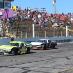 D.J. Shaw (60) passed Tyler Church on the last lap to win the PASS South Easter Bunny 150 on April 20 at Hickory (N.C.) Motor Speedway. (Adam Fenwick photo)