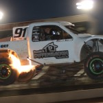 Nick Tyree's PRO 2 truck spits fire during Friday's TORC event at The Dirt Track at Charlotte Motor Speedway. (Adam Fenwick Photo)