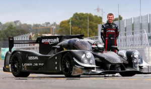 Mark Schulzhitskiy poses with the Onroak Automotive Ligier JS P2 entry that he has been testing.