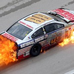Dale Earnhardt Jr.'s No. 88 Chevrolet burns after a crash early in Monday's NASCAR Sprint Cup Series race at Texas Motor Speedway. (NASCAR Photo)