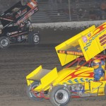 Sammy Swindell (1) takes the high road to lap A.J. Bruns (44) during the World of Outlaws Sprint Car feature Saturday at Federated Auto Parts (Mo.) Speedway at I-55. (Donald Figler photo)