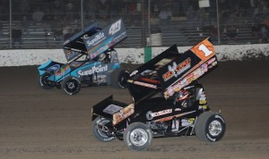 Sammy Swindell (1) races under Brad Sweet en route to his first World of Outlaws STP Sprint Car Series victory of the season Saturday at Federated Auto Parts Raceway at I-55. (Don Figler photo)