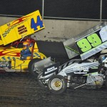 A.J. Bruns (44) battles Korey Weyant during Friday's MOWA sprint-car feature at Tri-City Speedway. (Mark Funderburk Photo)