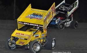 Daryn Pittman (9) chases Joey Saldana Saturday night at Devil's Bowl Speedway. (Boyd Adams photo)