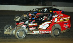 Jeff Strunk (4) battles Tommy Sheetz during modified action at Grandview Speedway Saturday. (Rich Kepner Photo)