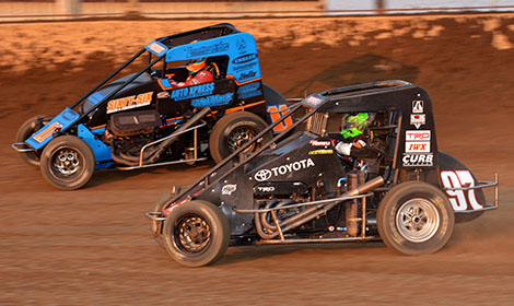 No. 97 Rico Abreu battles  No. 11 Andrew Felker on his way to winning Saturday night's 40-lap feature as part of the Kokomo Grand Prix. (Dave Heithaus Photo)
