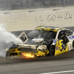 David Gilliland's damaged Ford sits on the front stretch after a crash during Saturday's 5-Hour Energy 400 at Kansas Speedway. (HHP/Rusty Jarrett Photo)