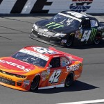 Kyle Larson (42) leads Kyle Busch during Saturday's NASCAR Nationwide Series event at Charlotte Motor Speedway. (HHP/Alan Marler Photo)