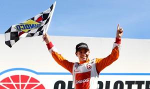 Kyle Larson celebrates after winning Saturday's NASCAR Nationwide Series History 300 at Charlotte Motor Speedway. (HHP/Christa L. Thomas Photo)