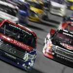 Kyle Busch (51) leads the NASCAR Camping World Truck Series field during Friday's event at Charlotte Motor Speedway. (HHP/Gregg Ellman Photo)