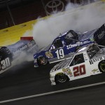 Ron Hornaday Jr. (30) spins in front of Brad Keselowski (19) and Austin Dillon during Friday's NASCAR Camping World Truck Series race at Charlotte Motor Speedway. (HHP/Ashley Dickerson Photo)