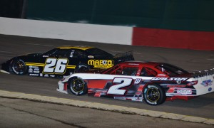 Donnie Wilson (2w) races under Bubba Pollard at Montgomery (Ala.) Motor Speedway earlier this month. Wilson won Saturday's Southern Super Series event at Mobile Int'l Speedway. (Chris Seelman Photo)