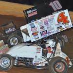Danny Smith (4) races Terry Gray during Saturday's USCS Outlaw Thunder Tour feature at Smoky Mountain Speedway. (Chris Seelman Photo)