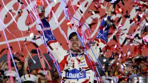 Jimmie Johnson celebrates in victory lane after winning the NASCAR Sprint Cup Series Coca-Cola 600 at Charlotte Motor Speedway on May 25, 2014 in Concord, N.C. (NASCAR/Getty Images photo)