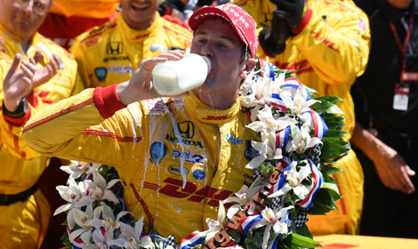 Ryan Hunter-Reay takes the traditional drink of milk in victory lane after winning the 98th Indianapolis 500 Sunday. (Al Steinberg Photo)
