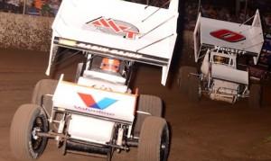 Jason Johnson leads Randy Martin (0) during ASCS Warrior sprint car competition at Double X Speedway Sunday night. (Ken Simon photo)