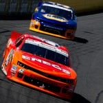 Kyle Larson (42) leads they way during Saturday's NASCAR Nationwide Series race at Charlotte Motor Speedway. (NASCAR Photo)