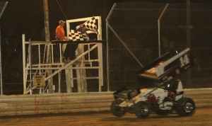 Dale Blaney takes the checkered flag Friday night at Attica (Ohio) Raceway Park. (Julia Johnson photo)