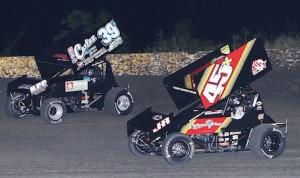 Johnny Herrera (45) battles Travis Rilat during ASCS sprint car competition at Golden Triangle Raceway Park. (RonSkinnerPhotos.com photo)