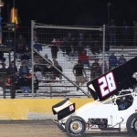 Tommy Bryant crosses the finish line to win Friday's ASCS Gulf South Region event at Golden Triangle Raceway Park in Beaumont, Texas. (RonSkinnerPhotos.com Photo)