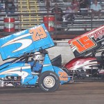 Mike Walling (29) and Travis Elliott battle during Saturday's ASCS Gulf South Region event at Battleground Speedway. (RonSkinnerPhotos.com Photo)