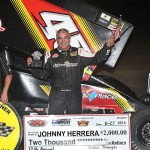 Johnny Herrera celebrates after winning Sunday's ASCS Gulf South Region feature at Golden Triangle Raceway Park. (RonSkinnerPhotos.com Photo)