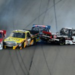 Timothy Peters (17), German Quiroga (77), Spencer Gallagher (23) and Ron Hornaday Jr. crash on the opening lap of Friday's NASCAR Camping World Truck Series race at Kansas Speedway. (NASCAR Photo)