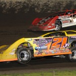 Billy Moyer Jr. (21jr) battles Shannon Babb during Friday's Lucas Oil Late Model Dirt Series event at Tri-City Speedway. (Don Figler Photo)